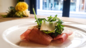 Cured 'Lonza' meat with rocket and shaved parmesan salad with lemon dressing