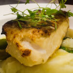 Pan fried sea bass fillet with asparagus and lemon butter sauce